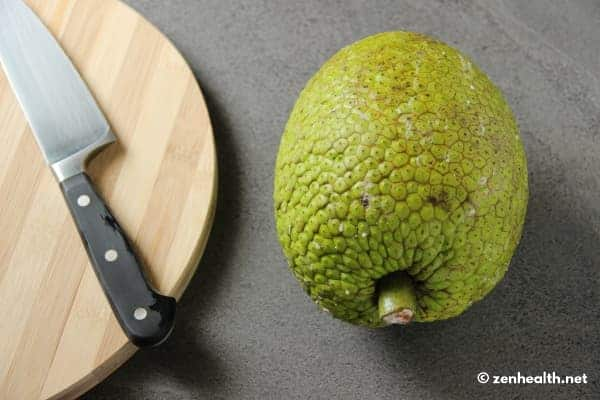 Breadfruit unpeeled with knife