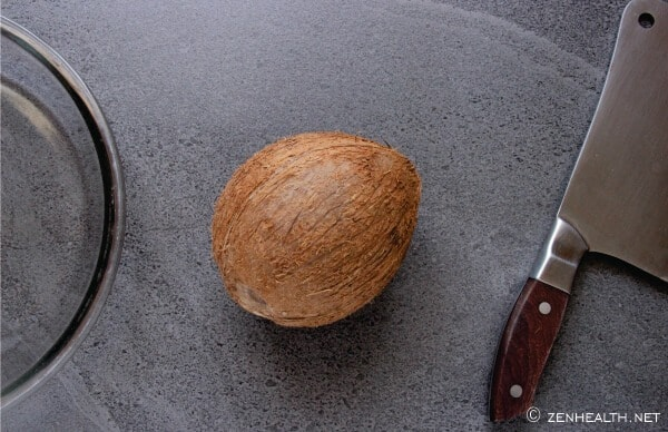 Coconut, bowl and cleaver
