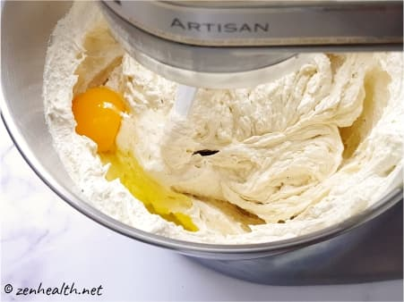 mixing eggs into batter