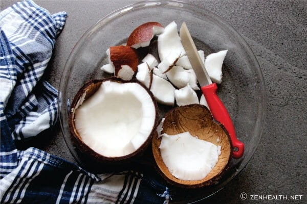 Removing coconut meat with knife